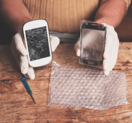 A technician is fixing and replacing the broken screen on a smart phone